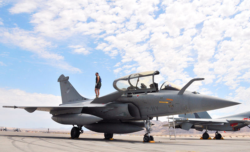 A crewman performs a post-flight check on a Armee de l'Air (French Air Force) Rafale B fighter at Nellis Air Force Base, Nevada (USA), on 7 August 2008. The French Rafale was from Escadre de Chasse 2/7