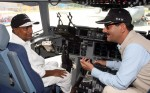 A seemingly indulgent AK Antony in the cockpit of the aircraft with an animated Jitendra Singh, who has a keen interest in aviation | DPR, Defense Ministry